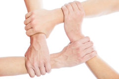 Solidarity concept using joined hands Stock Photography