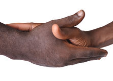 Solidarity gesture of hands. Solidarity is the social bond of reciprocal commitment and dependence between persons thus held to the welfare of others, usually Stock Photography