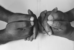 Solidarity gesture of hands. Solidarity is the social bond of reciprocal commitment and dependence between persons thus held to the welfare of others, usually Stock Images