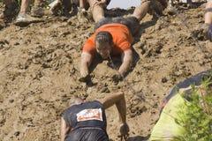 Solidarity through the participant at Mud run Royalty Free Stock Photo