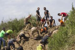 Solidarity through the participant at Mud run Stock Photos