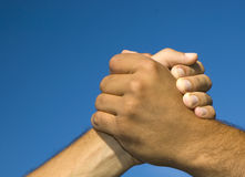 Solidarity and peace. Symbol of solidarity and peace on blue background stock photography