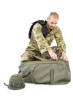 Solider packing his bag Stock Images