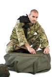 Solider packing his bag Stock Photos