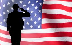 Solider Saluting Against The American Flag. Silhouette Of A Solider Saluting Against The American Flag stock images