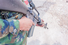 Solider thai navy use right hand hold weapon Stock Images