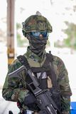 Soldier uniform hold weapon. Solider wear uniform hold on the shoot gun royalty free stock photography