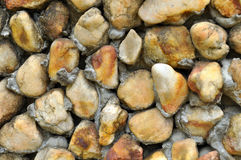 SOLIDIFICATION WALL. Plutonic igneous rock in grainy texture stuck close to each other using cement to solidify a modern building wall Stock Photo