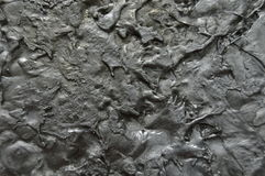 Solidified liquid aluminum. Closeup photo of a sample of solidified liquid aluminum. Gray, black and silver tones royalty free stock photos
