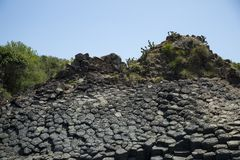 Solidified volcanic rock on the sea shore Royalty Free Stock Photos