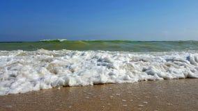 Solig havsvåg med sand royaltyfria bilder