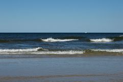 solig stranddag Arkivbild
