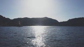 Soligt väder på Como sjön arkivfilmer