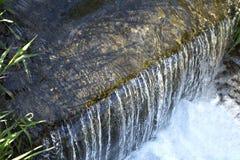 Solilsken blick på vattnet Royaltyfri Foto