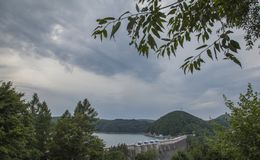 Solina Lake, Poland, Europe - cloudy sky and the dam. This image shows a view of some cloudy skies and the dam on Solina Lake, south Poland, Europe. The picture royalty free stock photo