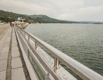 Solina Lake, south Poland - grey waters. This image shows a view of some grey waters and a dam on Solina Lake, south Poland, eastern Europe. The picture was royalty free stock image