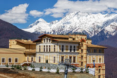 Solis Sochi Hotel on a sunny mountain slope background. Sochi, Russia - April 10, 2014: Gorgeous Solis Sochi Hotel is located on a sunny mountain slope alongside Royalty Free Stock Images