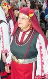 Solista do coro nacional do ` s das mulheres nos jogos de Nestinarski em Bulgária Imagem de Stock