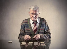 Solitaire. Senior man playing solitaire with cards Stock Photo