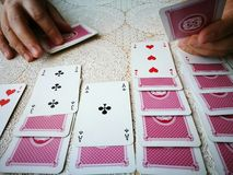 Solitaire. Artistic look in vintage vivid colours. Cartomancy in the service of humanity Royalty Free Stock Photography