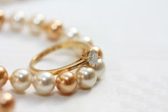 Solitaire diamond ring on pearls Stock Photography