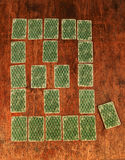 Solitaire of playing cards on a wooden table Royalty Free Stock Photos