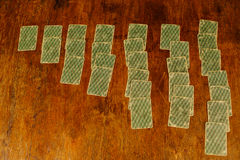 Solitaire of playing cards on a wooden table Stock Image