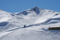 Man skiing on snowy mountain. Solitary man skiing on snowy mountain in Chile Stock Photo