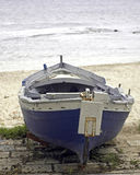 Solitare boat. Small old boat near the beach in the afternoon sicily stock image