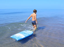 Solitary. Boy going to swim stock photos