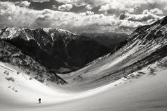All hail the pioneers. Solitary alpinist in a majestic winter environment Stock Images