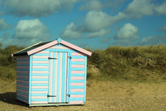 Solitary beach hut in the sand dunes. Stock Photography