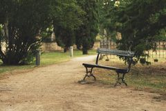 Solitary bench. A solitary bench in a park Royalty Free Stock Photos