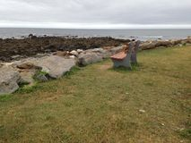 Bench beside the sea Royalty Free Stock Photo
