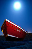 Solitary boat. Red boat photographed in night of moonlight Stock Photo