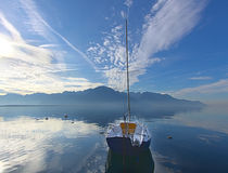 Solitary boat on a blue lake Royalty Free Stock Images