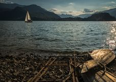 Solitary boat wood destroyed aground in a lonely beach. Lake stock images