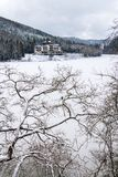 Solitary building in beautiful snowy winter forest landscape, frozen Brezova dam royalty free stock image