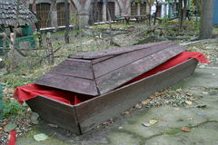 Solitary coffin. Left in left village Royalty Free Stock Photo