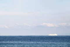 Solitary cruise ship in the ocean, dreamy Royalty Free Stock Photo