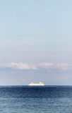 Solitary cruise ship in the ocean, dreamy Stock Photo