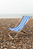 Solitary deckchair - Grey Day - vertical Royalty Free Stock Photos