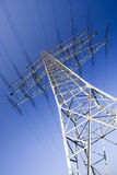 Solitary electricity pylon. Against a blue sky - adobe RGB royalty free stock image