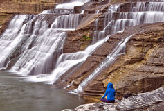 Solitary figure next to Ithaca Falls in rural New York Stock Photo