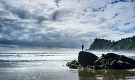 Solitary fisherman. Bahia Mansa, Osorno Chile. October 30, 2017. Beautiful rustic beach in southern Chile. Solitary fisherman.Icy waters and dangerous but very Stock Photo