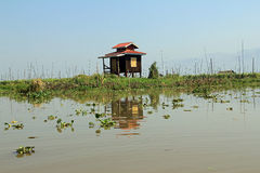 A solitary house on Inle Lake Stock Image