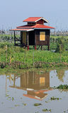 A solitary house on Inle Lake with yellow door Royalty Free Stock Images