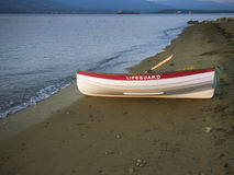 Solitary Lifeguard boat on beach Stock Photography