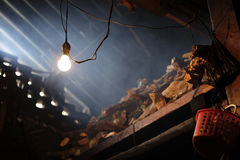 Solitary light on rustic firewood store stock photo