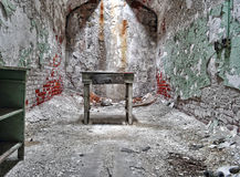 Solitary. A lone desk in the confines of Eastern State Penitentiary Stock Image